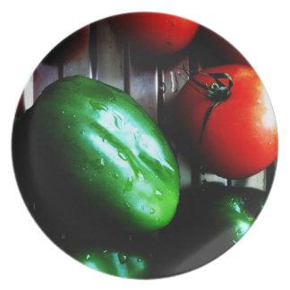 Tomates y pimienta verde platos de comidas