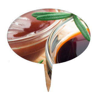 Tomato ketchup and soy sauce in a transparent bowl cake topper