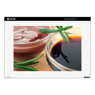 "Tomato ketchup and soy sauce in a transparent bowl decal for 15"" laptop"