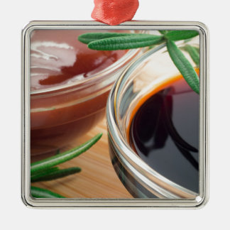 Tomato ketchup and soy sauce in a transparent bowl metal ornament