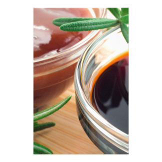 Tomato ketchup and soy sauce in a transparent bowl stationery