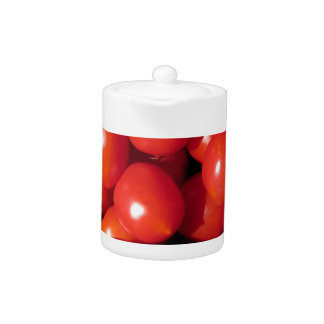 Tomatoes background teapot