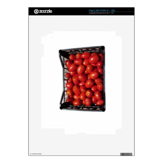 Tomatoes in box on white background skins for the iPad 2