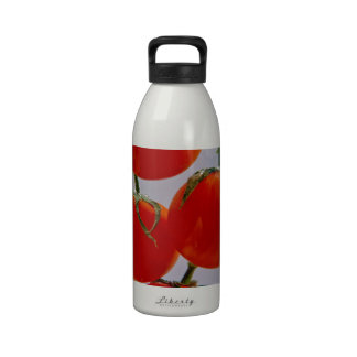 Tomatoes in glass of water reusable water bottles
