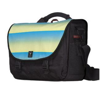 Tono amarillo y del azul dos bolsas de portatil