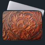 "Tooled Leather Laptop Sleeve 13 Inch<br><div class=""desc"">The perfect laptop sleeve for those desiring a western look! This design nicely depicts a tooled-leather rose and foliage. It is customizable -- text can be added for a truly unique and personal gift.</div>"