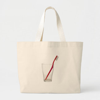 Toothbrush in a glass large tote bag