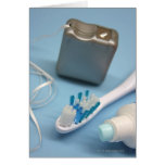 Toothbrush, toothpaste and floss. card