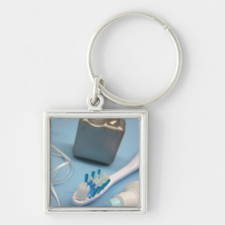 Toothbrush, toothpaste and floss. keychain