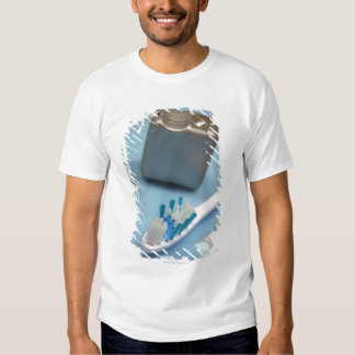 Toothbrush, toothpaste and floss. t shirt