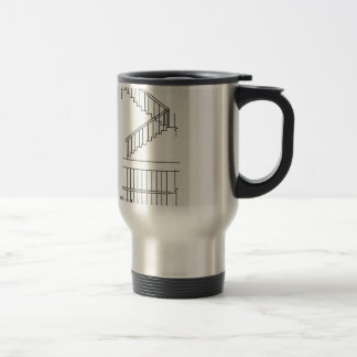 Top view and front view of a dog legged staircase travel mug