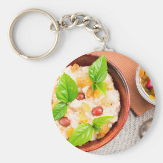 Top view close-up on an old wooden bowl of healthy keychain