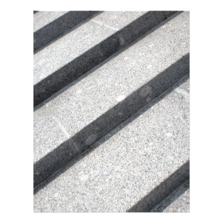 Top view closeup of gray marble step letterhead