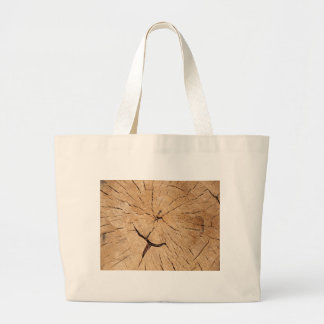 Top view closeup on an old tree stump large tote bag
