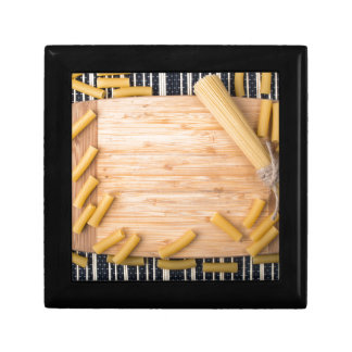 Top view food background made of thin spaghetti gift box