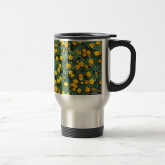 Top view of a big flower bed of yellow flowers 15 oz stainless steel travel mug