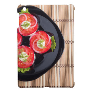 Top view of a dish with fresh sliced tomatoes cover for the iPad mini
