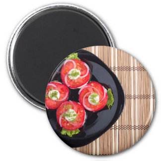 Top view of a dish with fresh sliced tomatoes magnet