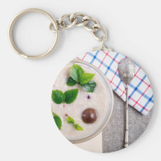 Top view of a healthy dish of oatmeal in a bowl keychain