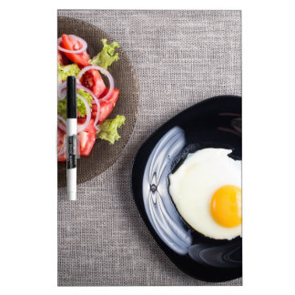 Top view of a healthy homemade breakfast of egg dry erase board