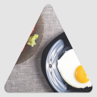 Top view of a healthy homemade breakfast of egg triangle sticker