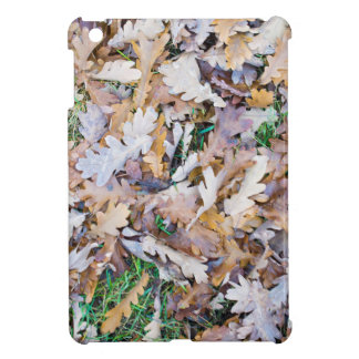Top view of a layer of fallen oak leaves iPad mini covers