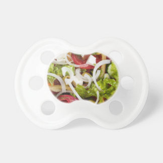 Top view of a plate of salad made from natural raw pacifier