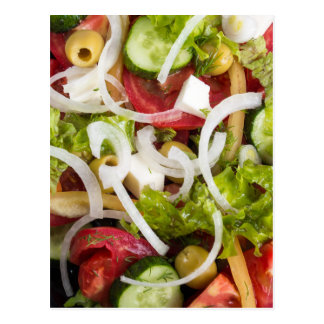 Top view of a plate of salad made from natural raw postcard