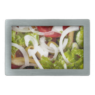 Top view of a plate of salad made from natural raw rectangular belt buckle