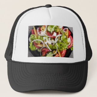 Top view of a plate of salad made from natural raw trucker hat