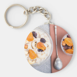 Top view of a portion of oatmeal with fruit keychain