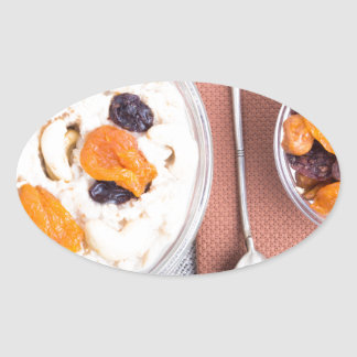 Top view of a portion of oatmeal with fruit oval sticker