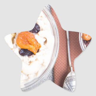 Top view of a portion of oatmeal with fruit star sticker