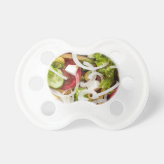 Top view of a salad made from natural vegetables pacifier