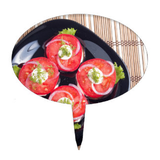 Top view of a sliced red tomatoes slices cake topper