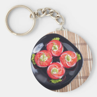 Top view of a sliced red tomatoes slices keychain