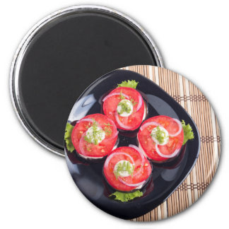 Top view of a sliced red tomatoes slices magnet