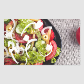 Top view of a small bowl of vegetables salad rectangular sticker
