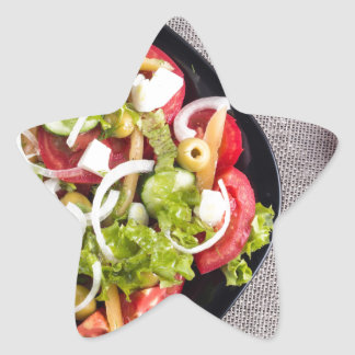 Top view of a small bowl of vegetables salad star sticker
