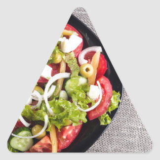 Top view of a small bowl of vegetables salad triangle sticker