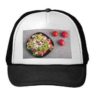 Top view of a small bowl of vegetables salad trucker hat