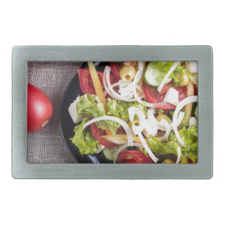 Top view of a small plate of raw salad belt buckle