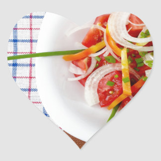 Top view of a small portion of vegetarian salad heart sticker