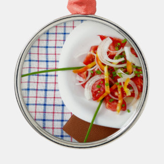 Top view of a small portion of vegetarian salad metal ornament