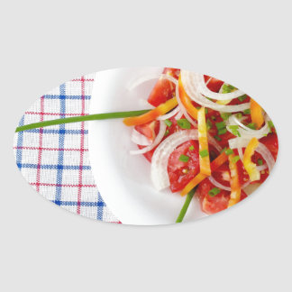 Top view of a small portion of vegetarian salad oval sticker