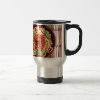 Top view of a thin spaghetti in a brown small wood travel mug