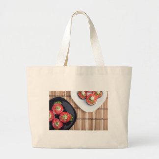 Top view of a vegetable dish large tote bag