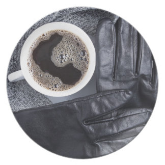 Top view of a white cup of coffee and gray woolen plate