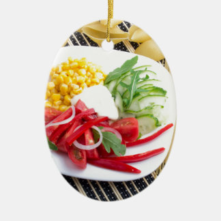 Top view of a white plate with salad ceramic ornament