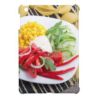 Top view of a white plate with salad iPad mini covers